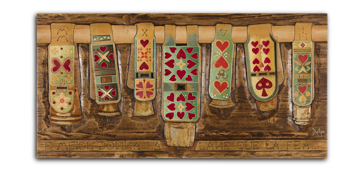 peinture et gravure sur bois d'une collection de colliers de brebis